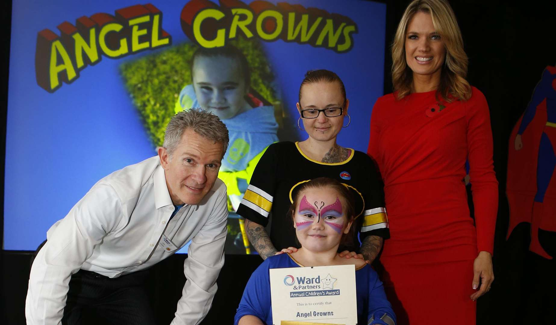 Charlotte Hawkins presents Angel Gowns with her Triumph Over Adversity for children aged 6-16 award. Picture by Andy Jones