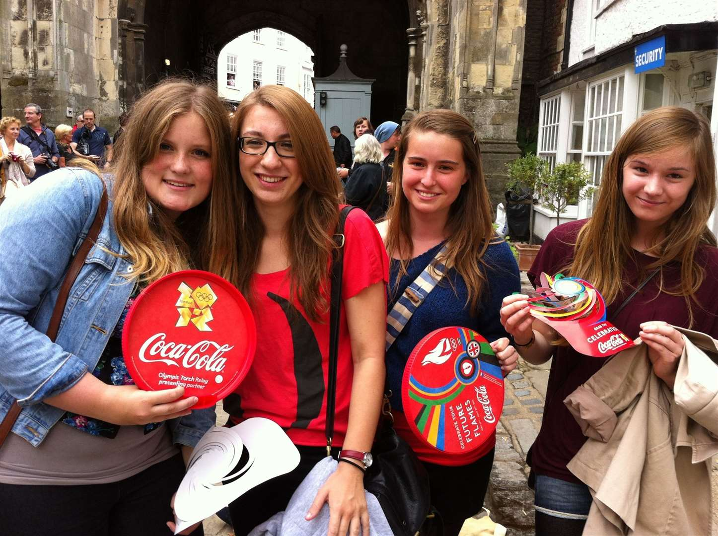 Hannah Tonry, Sophie Clark, Alice Golton and Eleanor Perkins, all 16, wait for the Olympic torch outside Canterbury Cathedral