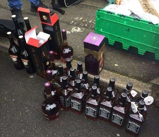 Police seized 25 bottles of alcohol found in a suspected stolen car on Saturday. Picture: Kent Police