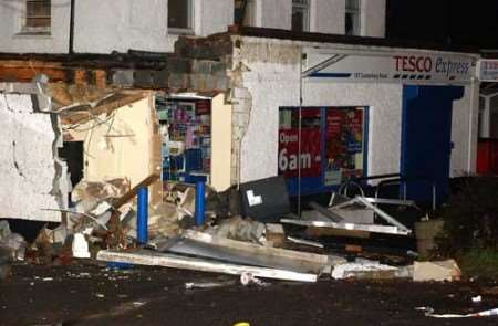 The raiders smashed through the shop front. Picture: TERRY SCOTT