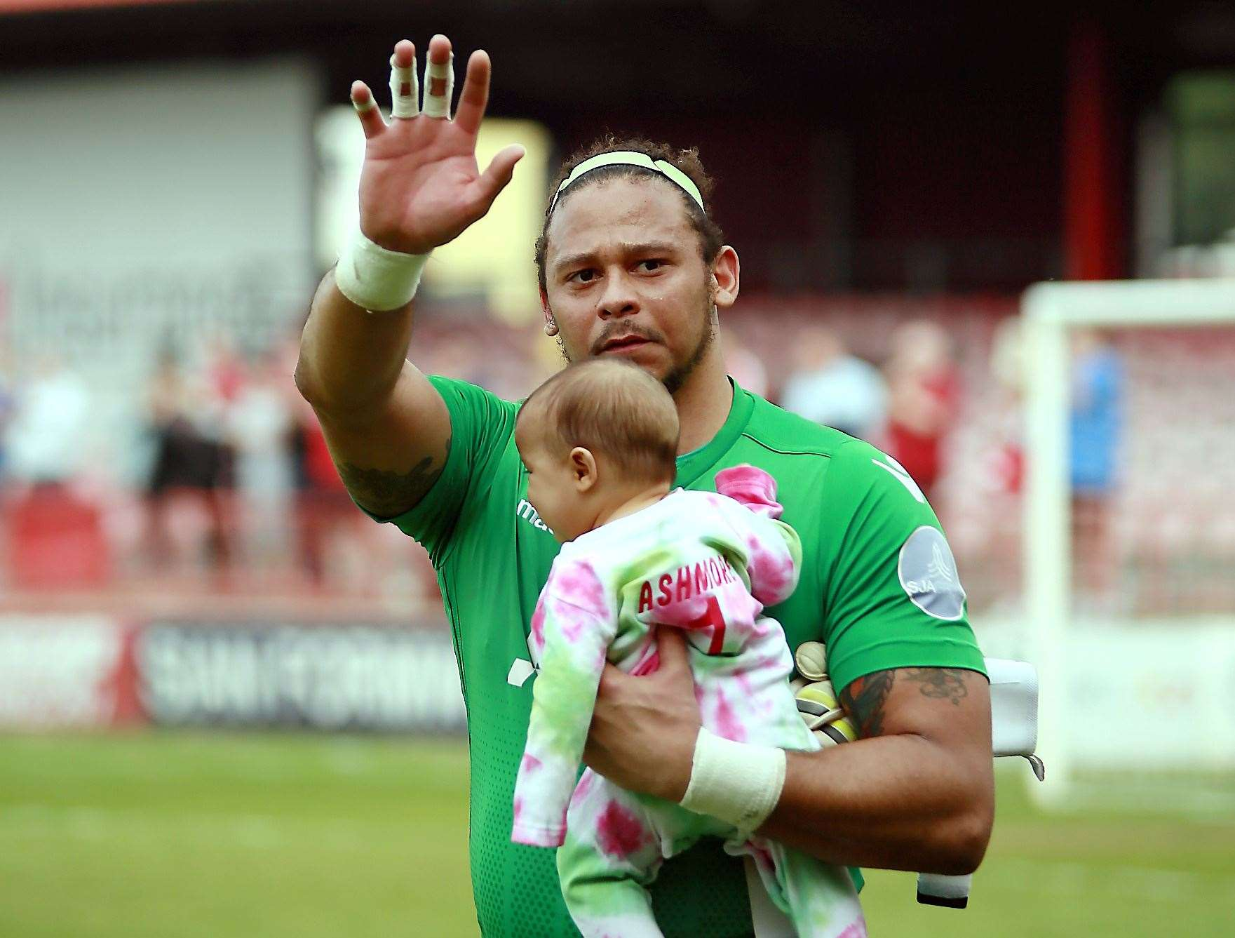 Ebbsfleet goalkeeper Nathan Ashmore with his daughter Naevia Monroe Picture: Phil Lee