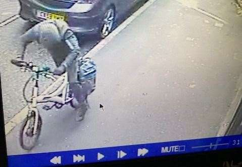 The crook flees with the £700 electric bike