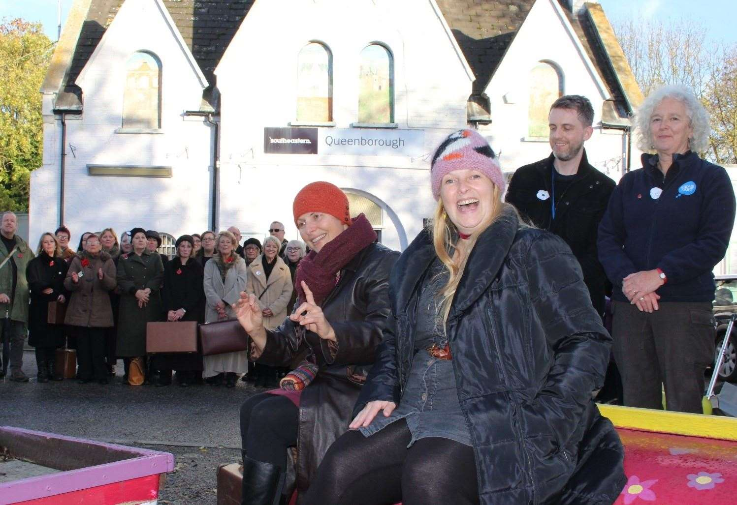 Tania Holland-Williams, left, and Emily Peasgood with Kevin Grist and Lucy Medhurst and the 55-plus choir at Queenborough railway station performing Never Again. Picture: John Nurden