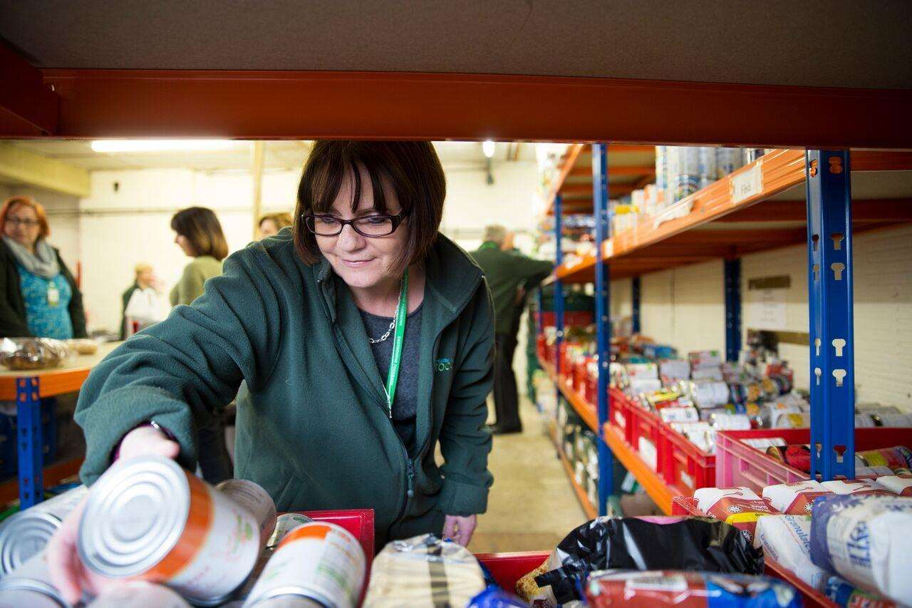A volunteer checks supplies at a Trussell Trust foodbank storage unit (5237603)