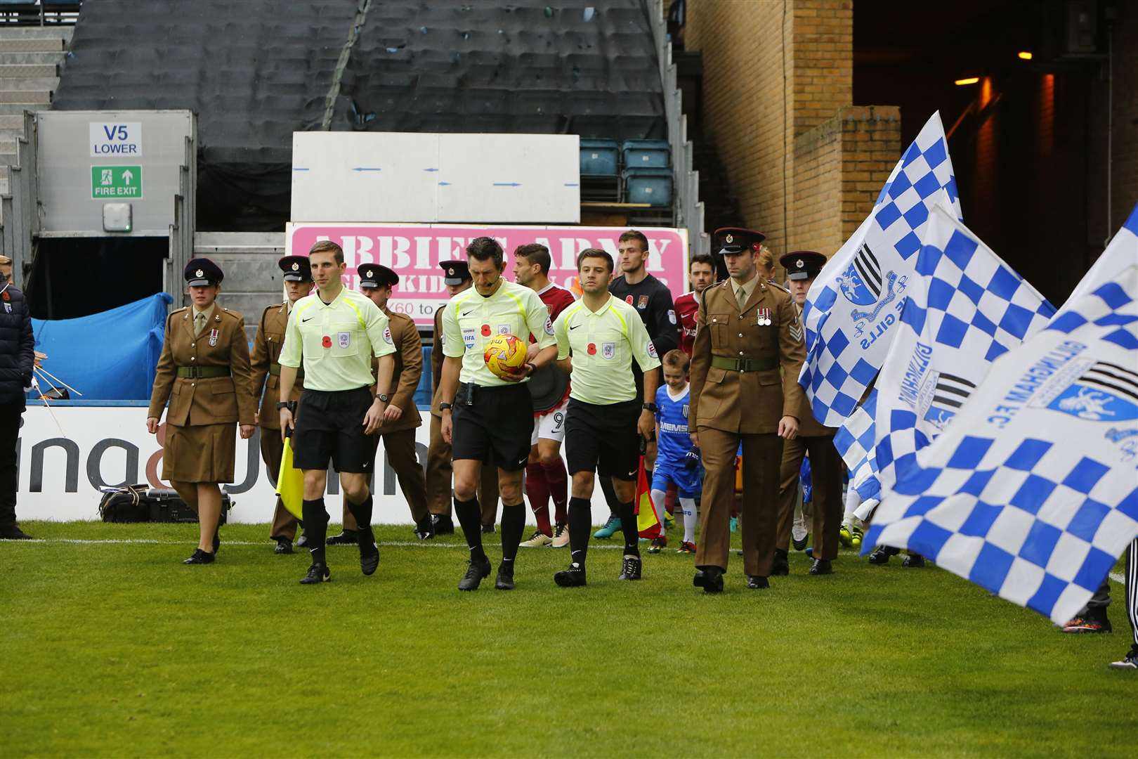 EReferee Lee Probert leads the Gills out at Priestfield against Northampton in November 2016, alongside the Royal Engineers. Picture: Andy Jones