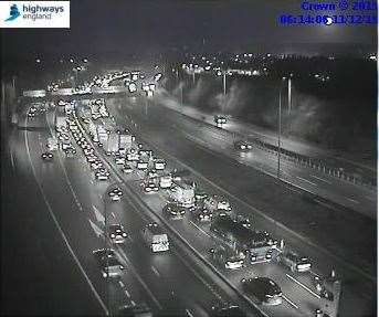 Traffic is queuing for miles on the M20 because of overrunning roadworks.