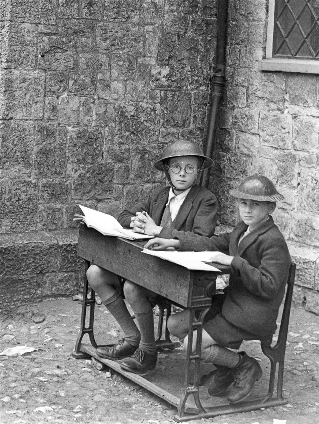 "Children joined in Doodlebug spotting duty. Gordon Spendley and Alan Chapman, did lessons while keeping an eye open outside Otham School. undated file pic. used in ""Recalling the Battle of Britain"" book by HRPB page 39. Negative Reference: no details (10436227)"