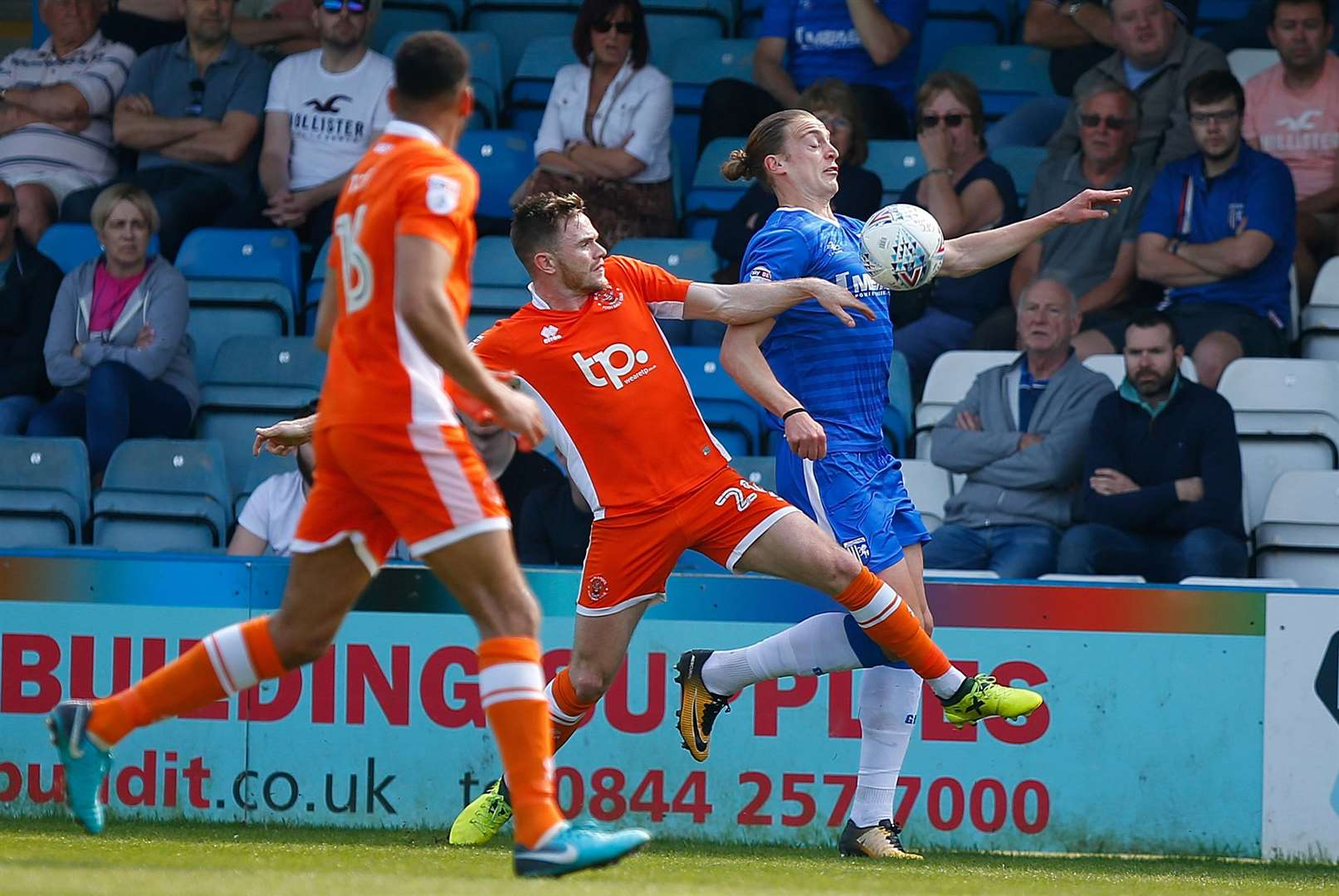 Tom Eaves battles the Tangerines defence Picture: Andy Jones