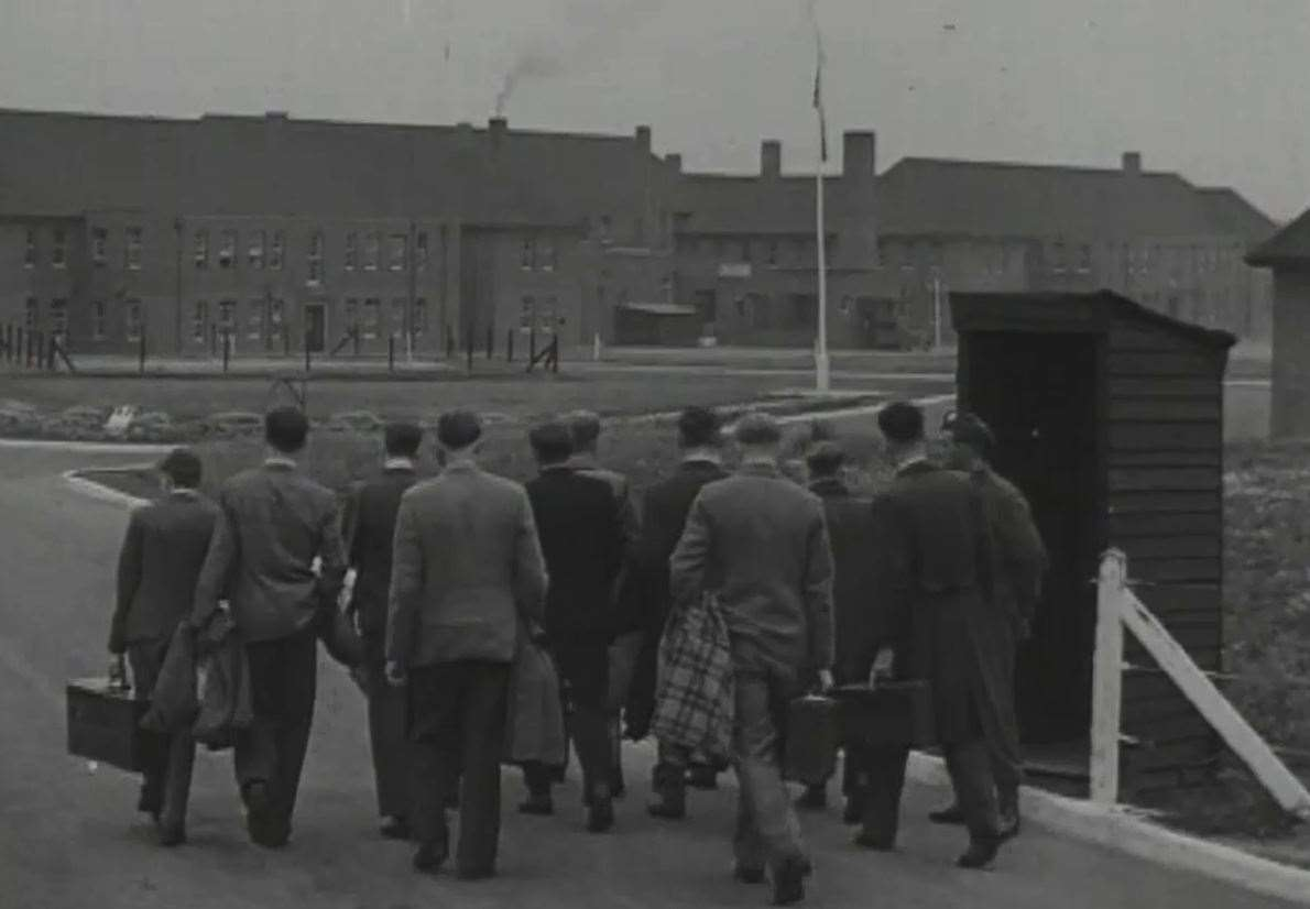 A draft of new National Service recruits arrives at barracks