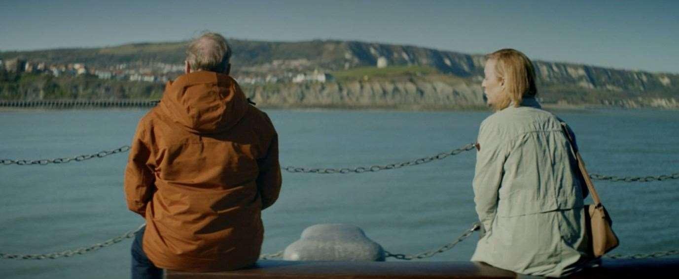 Two figures meet on Folkestone Harbor Arm.  Photo: BBC iPlayer