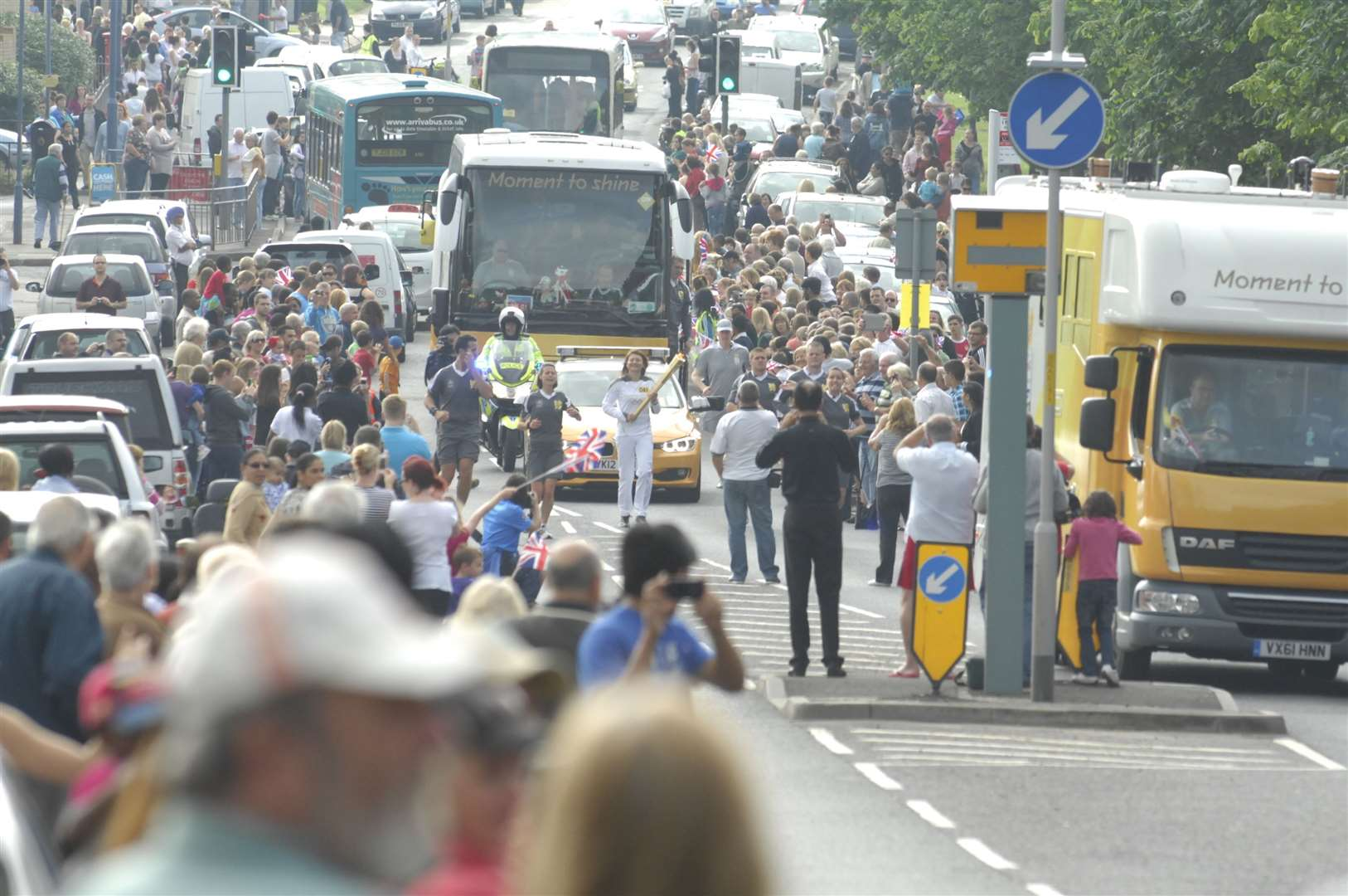 The crowds celebrate the torch passing through Gravesend, just before someone is arrested for making a grab for the flame