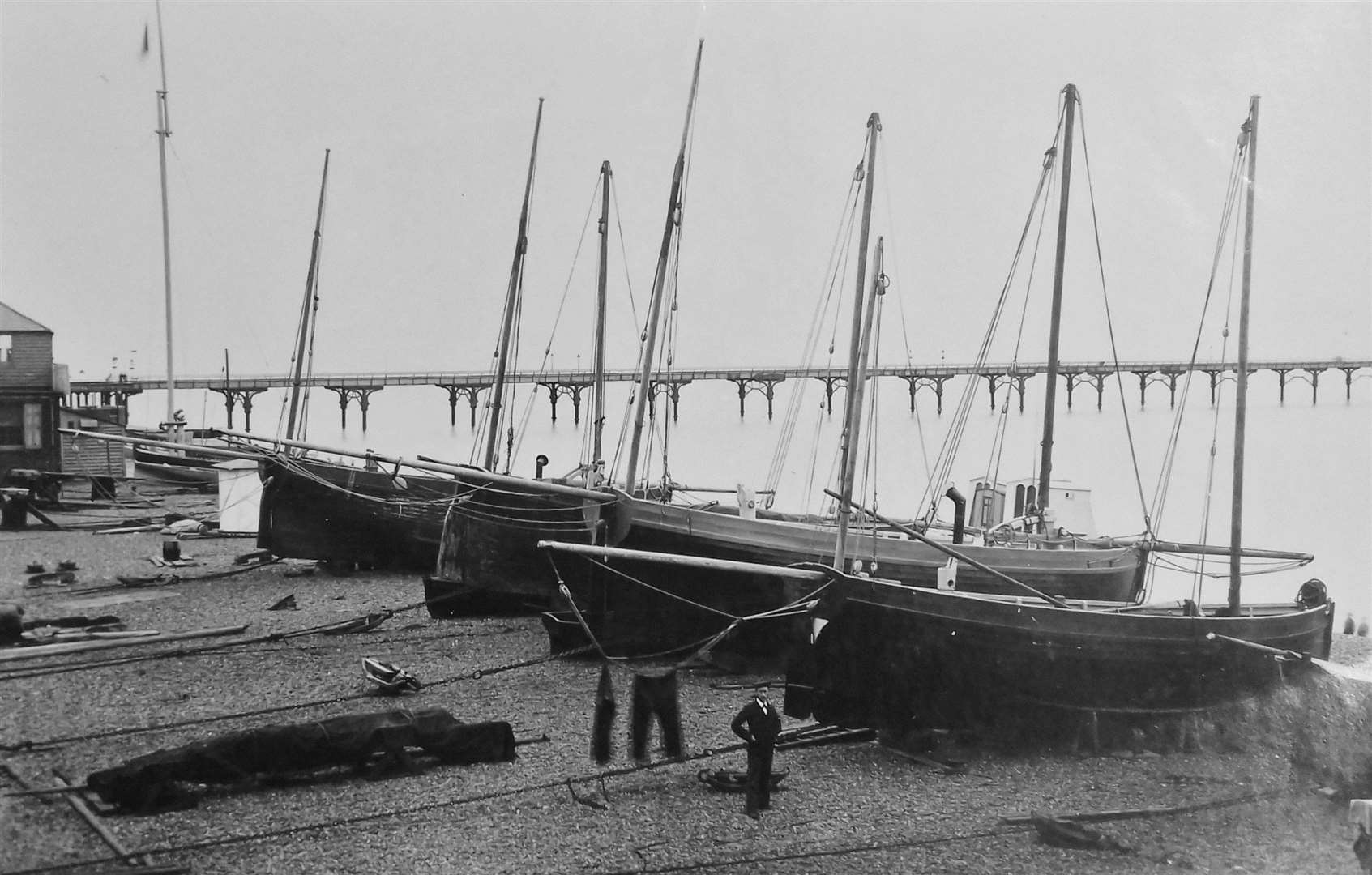 """South-end"" boats, with the iron pier in the background"