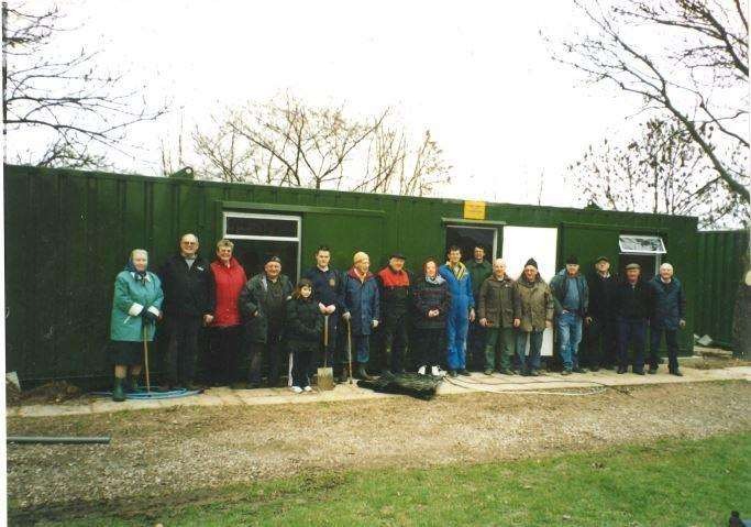 Members from the society standing outside the containers that were put up in 1994. Picture: GMME (7205708)