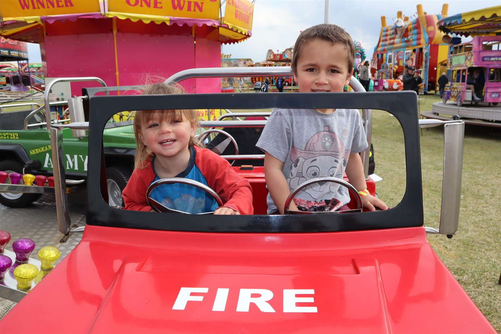 Charlotte Philcox, 2, and her brother Ralph, 4, rode the fire truck at Smith's funfair at Barton's Point, Sheerness
