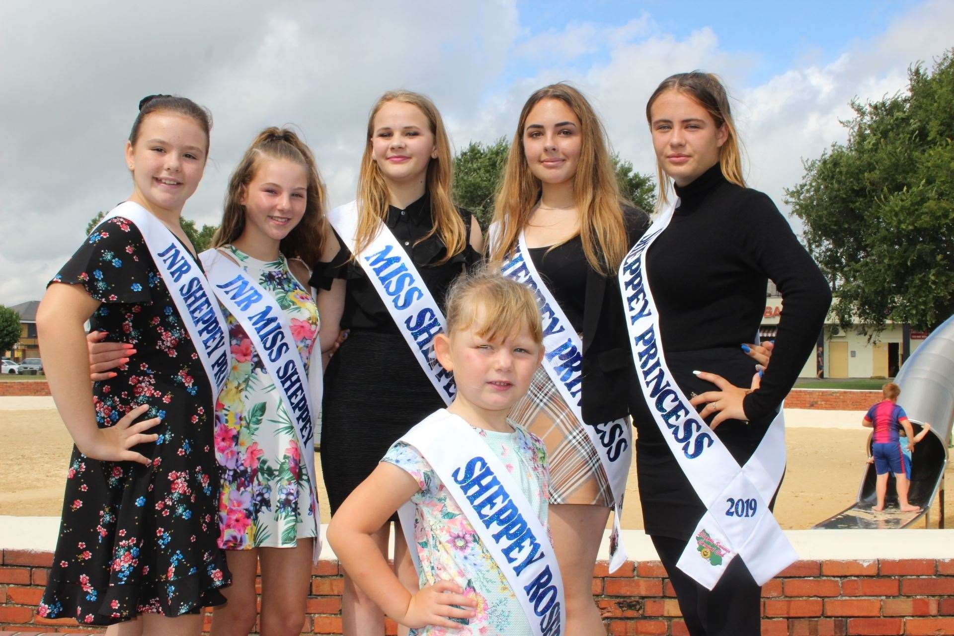 Sheppey carnival girls at the sandpit preparing for their big parade on Saturday. From the left, Lois Kidd, 10, Keira Collins-Kiazia, 13, carnival queen Melody Jackson, 15, Darcey Kidd, 14, and Paige Heaton, 14, with Sheppey Rosebud Evie Bowes, 5, in the front. Picture: John Nurden (15016565)