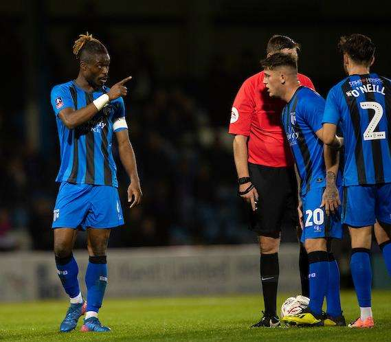 Darren Oldaker receves some advice from captain Gabriel Zakuani before Gills' last chance of the game. Oldaker put the free-kick well wide. Picture: Ady Kerry