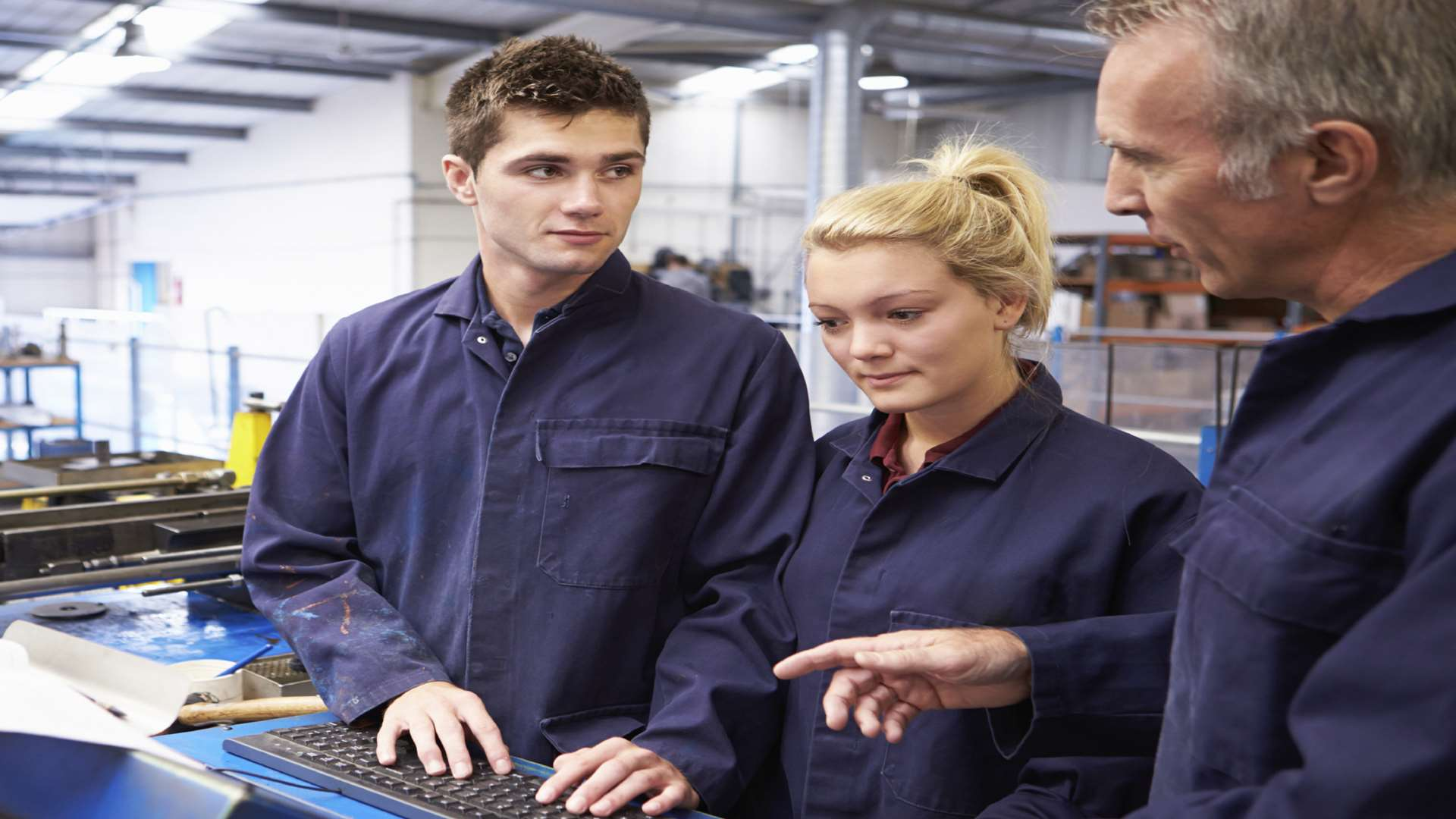 Engineer teaches apprentices