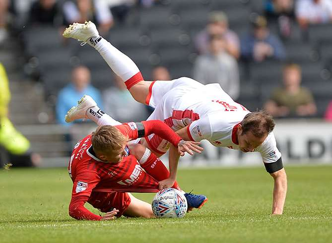 Gills striker Liam Nash in the thick of it at MK Dons Picture: Ady Kerry