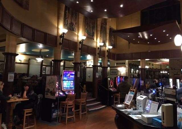 The screens, currently installed between tables and the fruit machines, look a little out of place next to the historic interior features