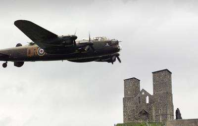 Lancaster bomber flying over Reculver
