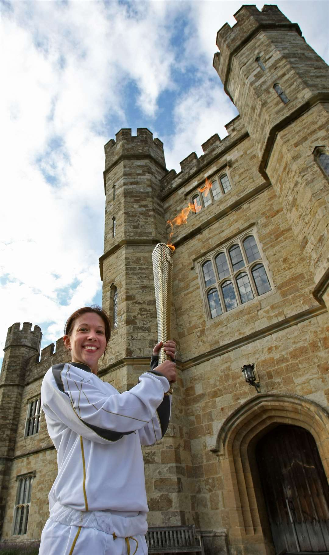 Sarah Shephard carries the flame at Leeds Castle. Pic: Locog