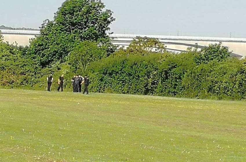 Police surround a young man in Borstal Recreational Ground (10790522)