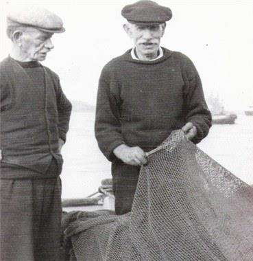 Mending nets. Bill's Grandfather, also Bill, carries out repairs watched by one of his brothers