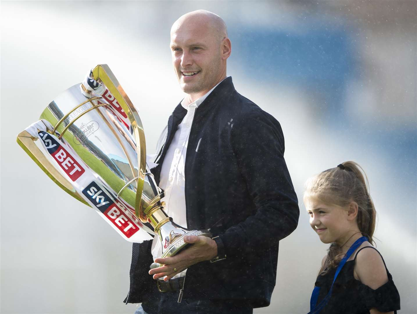 League 2 winning skipper Adam Barrett and his daughter were at Priestfield with the Championship trophy Picture: Ady Kerry