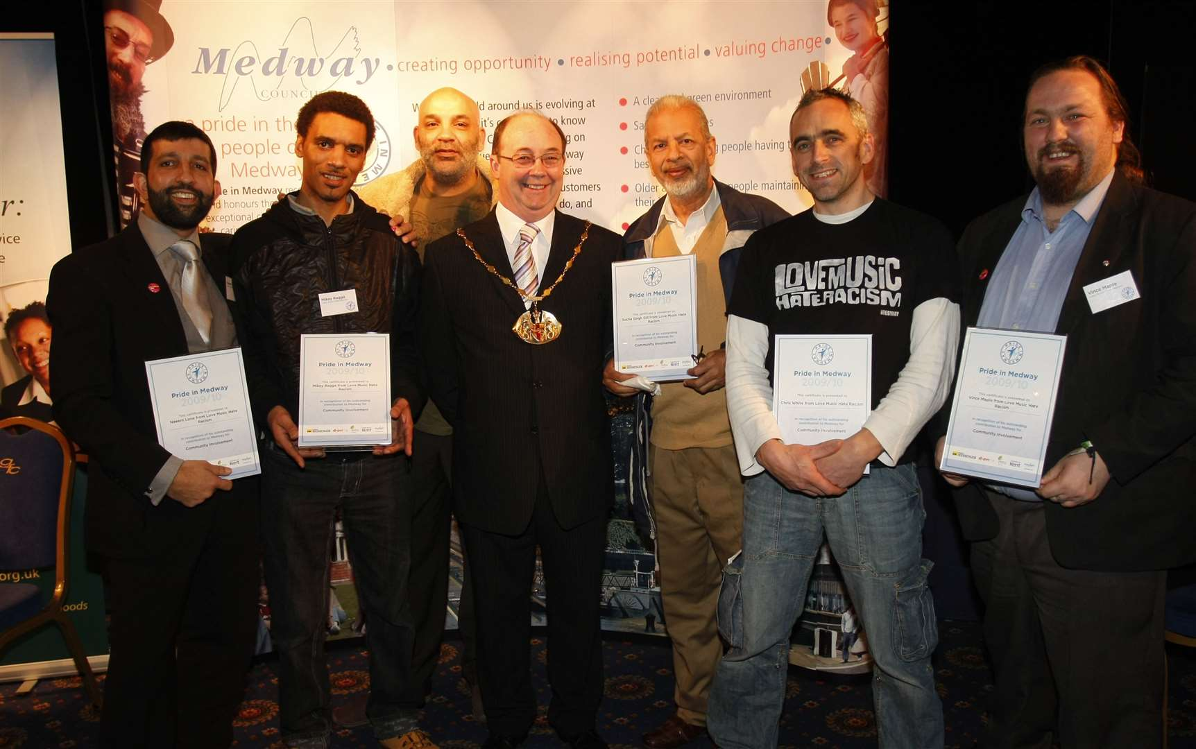 Sucha Singh Gill with members of The Love Music Hate Racism Group at a Pride in Medway awards night