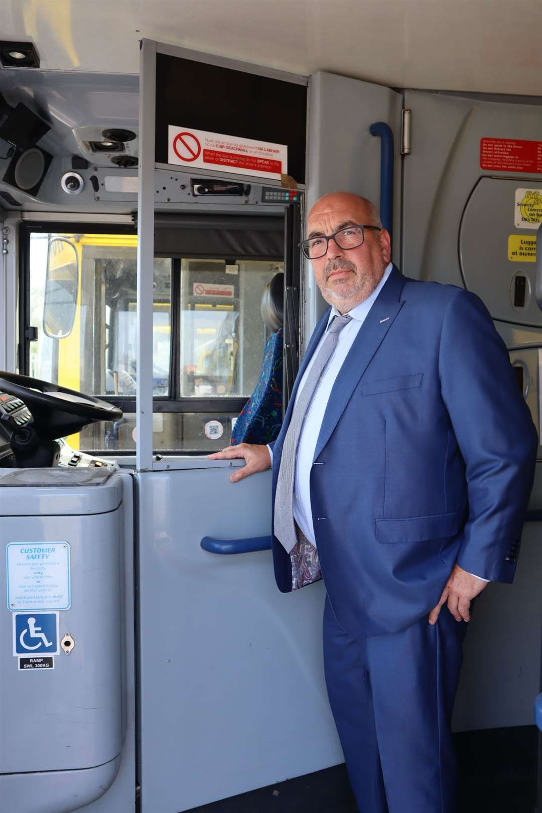 Tim Lambkin next to a driver's door shield being installed on all TravelMasters buses at the Sheerness depot on Sheppey