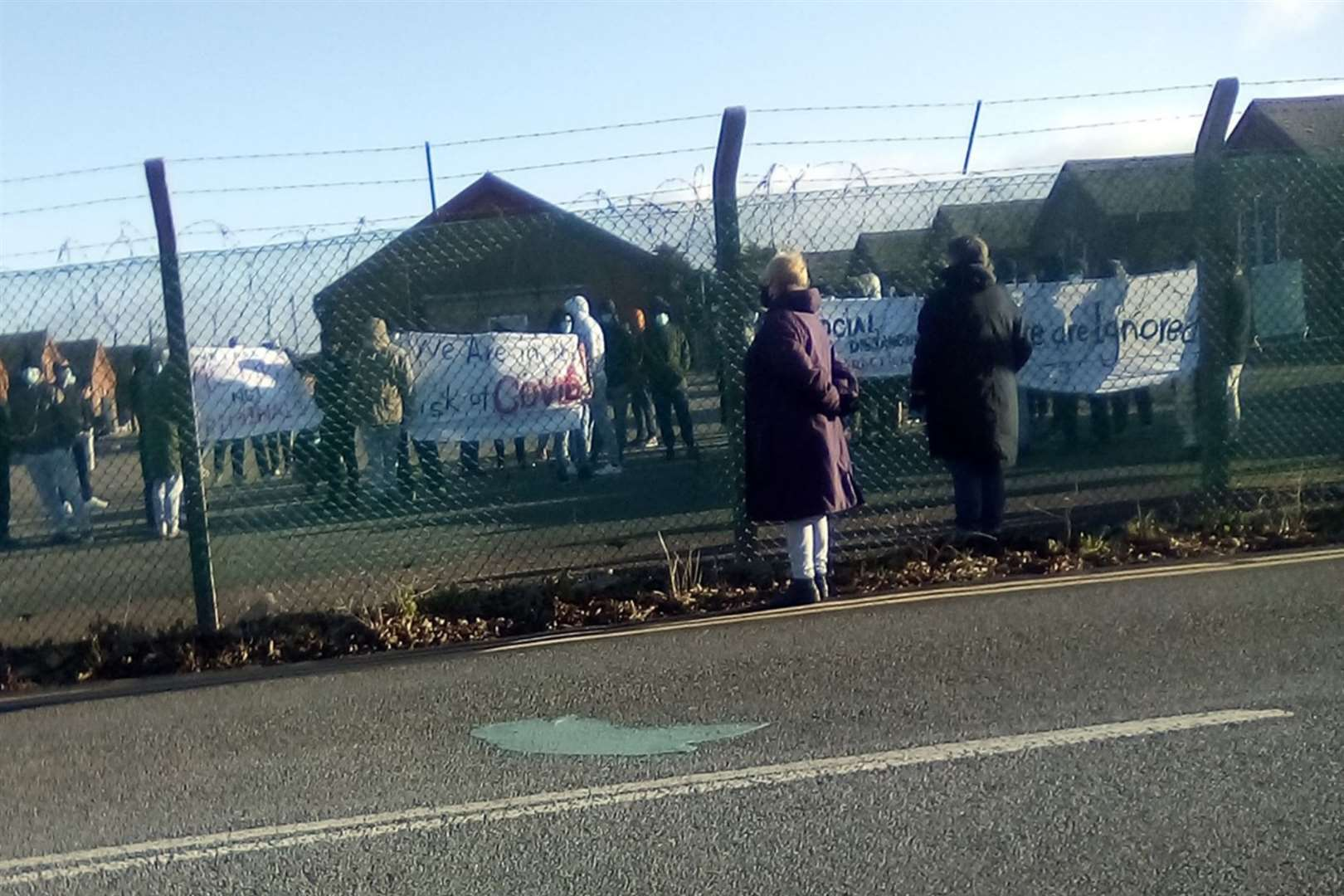 People seeking asylum protesting at Napier Barracks