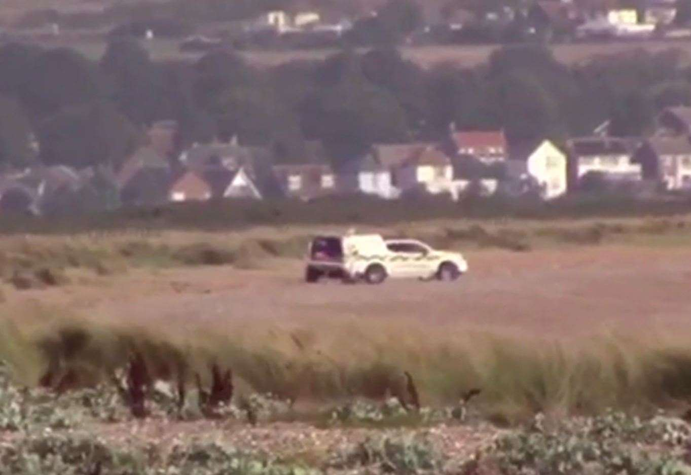 Footage taken on Saturday morning showed an emergency vehicle parked on the beach. Picture from video by Chris Johnson