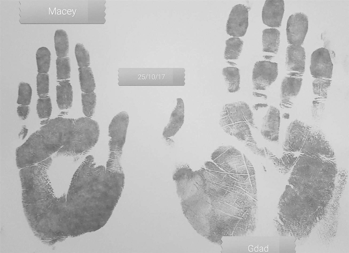 Macey and Marc's handprints side by side