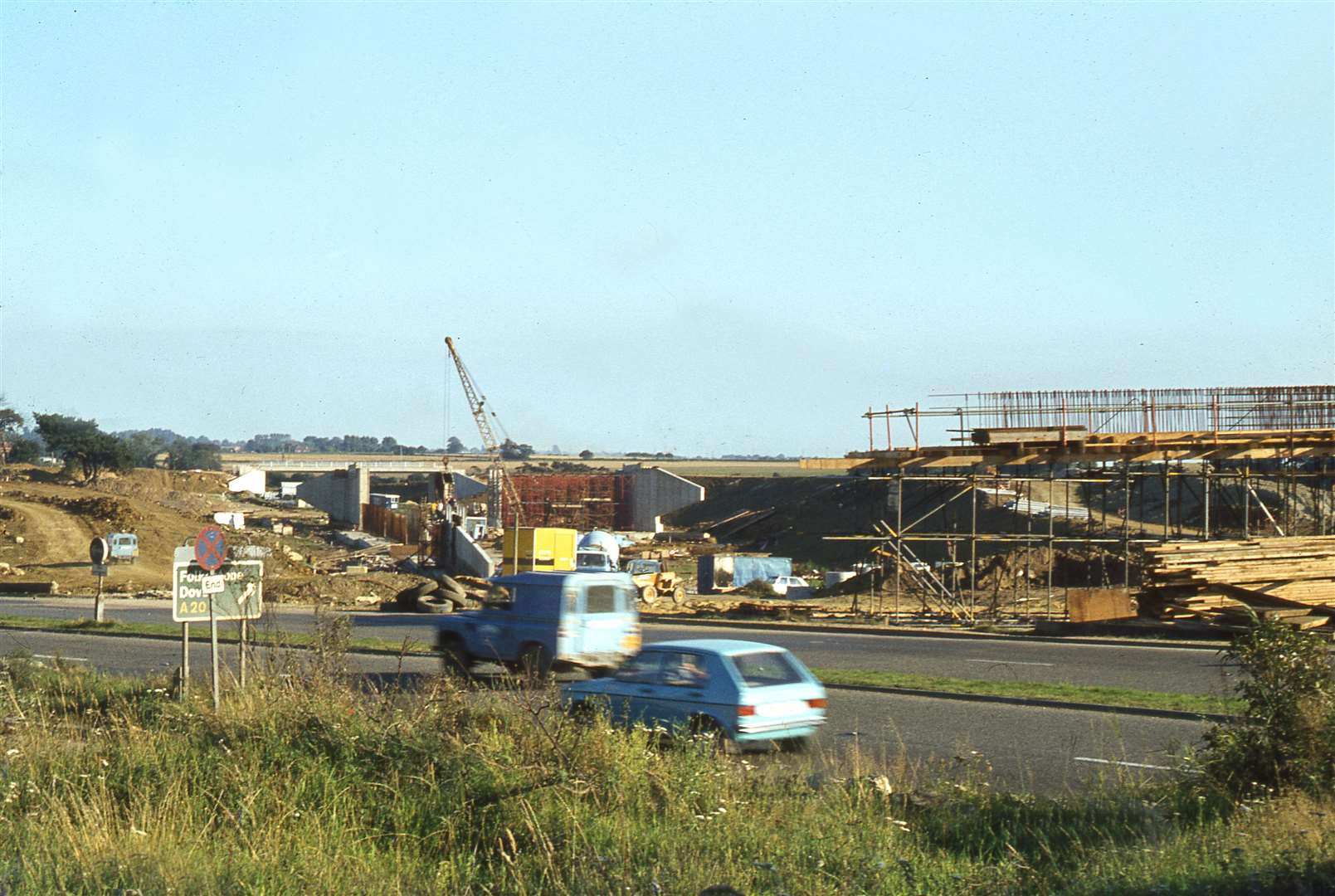 The dualled bypass section beside The Street, Willesborough continues to flow whilst the Junction 10 interchange is built in 1979. Picture: Neville Marsh