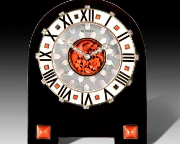 This 1920s Cartier black onyx and coral cased clock sold for £49,000