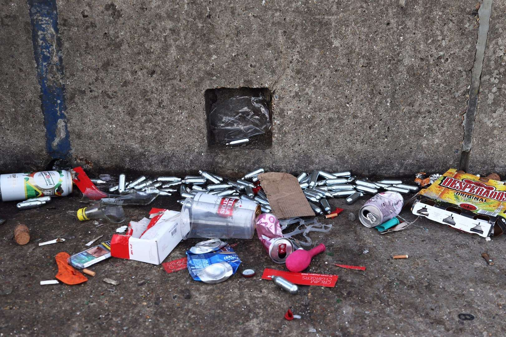 Laughing gas cannisters were strewn across the ground. Picture: Alex Hughes