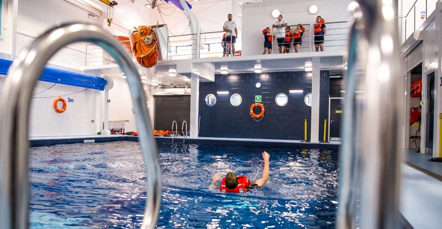 Supporting the practical application of our courses, simulating marine survival scenarios including escape shoots, life rafts, a rescue rib and a wind-farm turbine ladder.