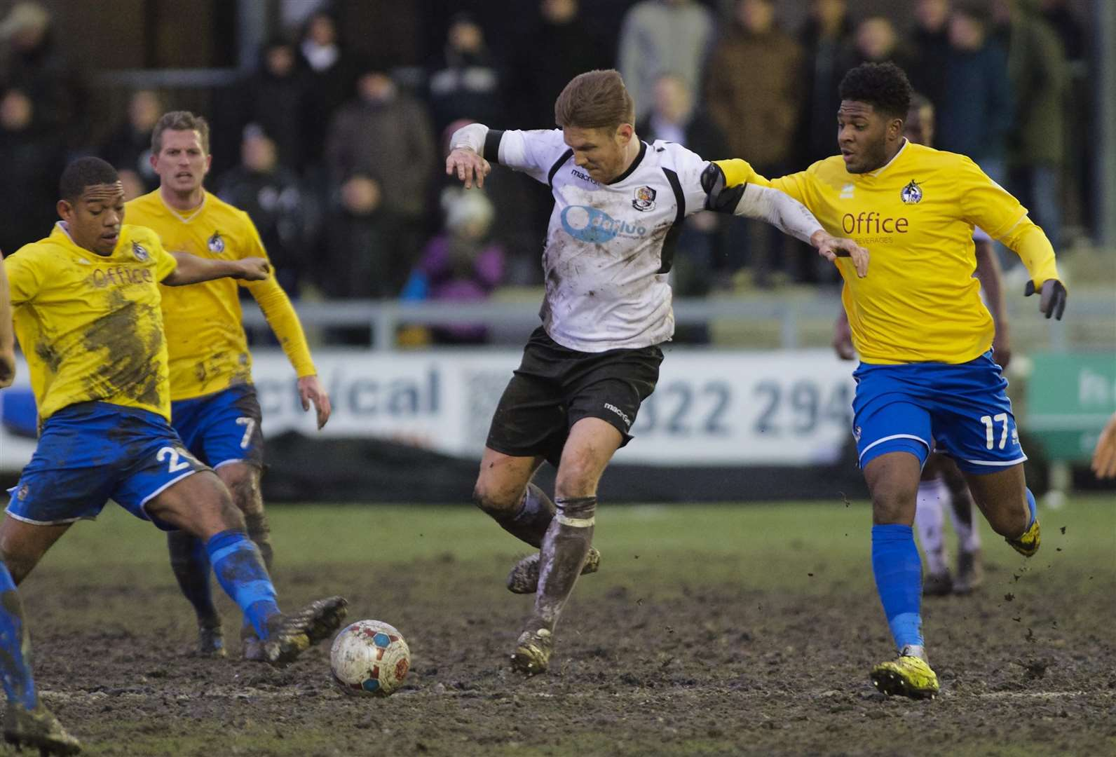 Elliot Bradbrook ploughs through the mud against Bristol Rovers Picture: Andy Payton