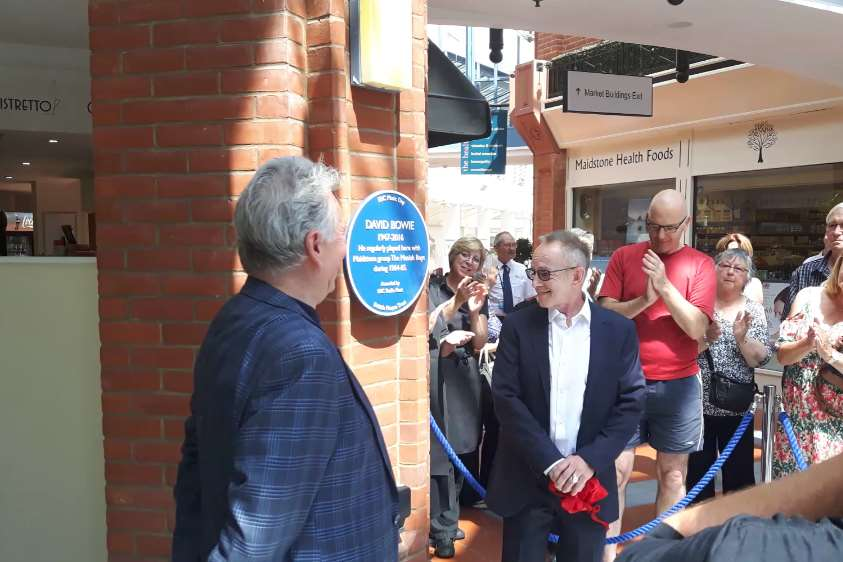"Bob Solly and Nick ""Topper"" Headon unveil the plaque to commemorate David Bowie's musical heritage in Maidstone."