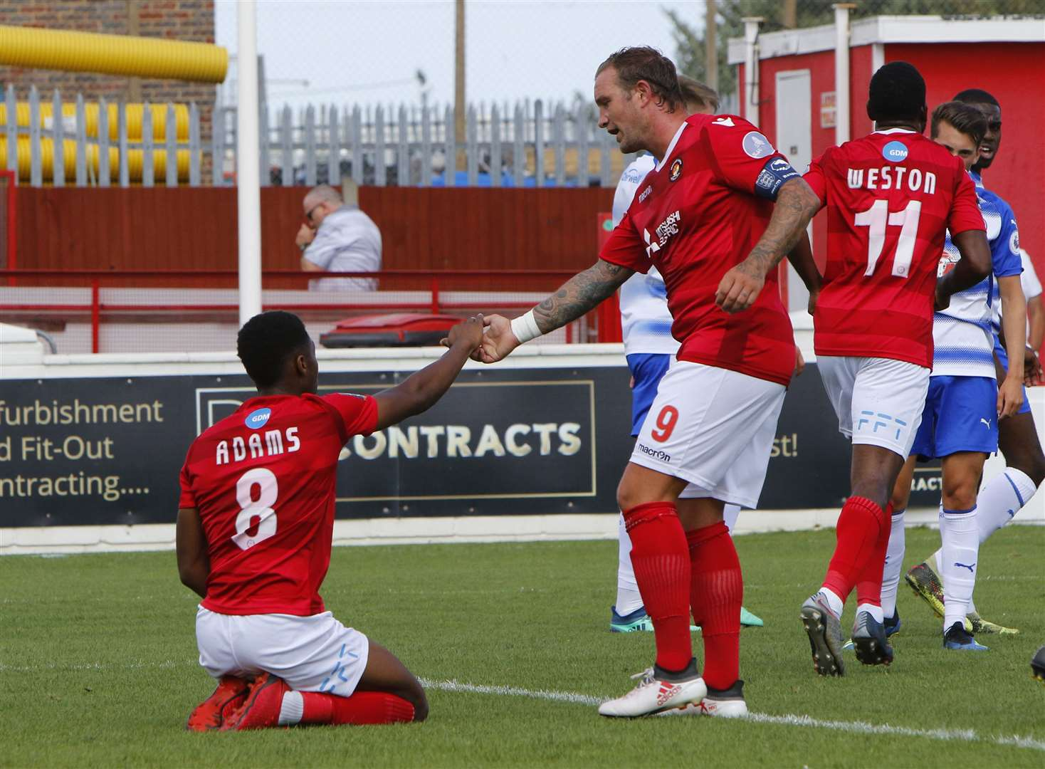 Danny Kedwell gives Ebou Adams a helping hand Picture: Andy Jones
