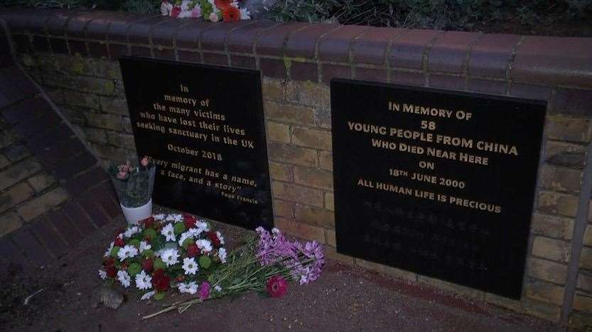 Flowers were laid at the plaques during the vigil