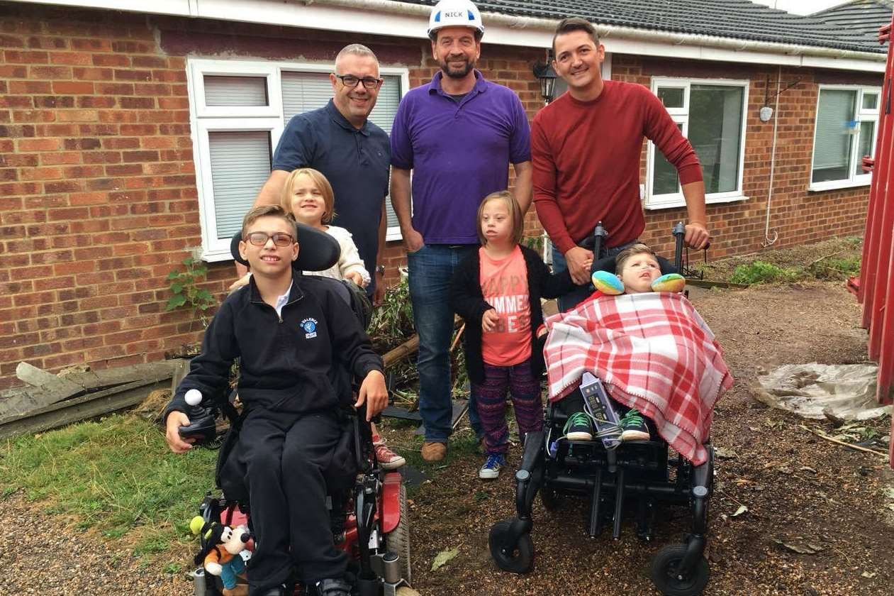 The Ratcliffe family with DIY SOS presenter Nick Knowles