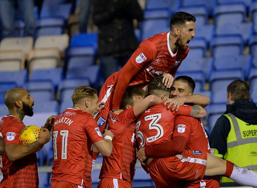 Gillingham celebrate their equaliser at Shrewsbury Picture: Ady Kerry