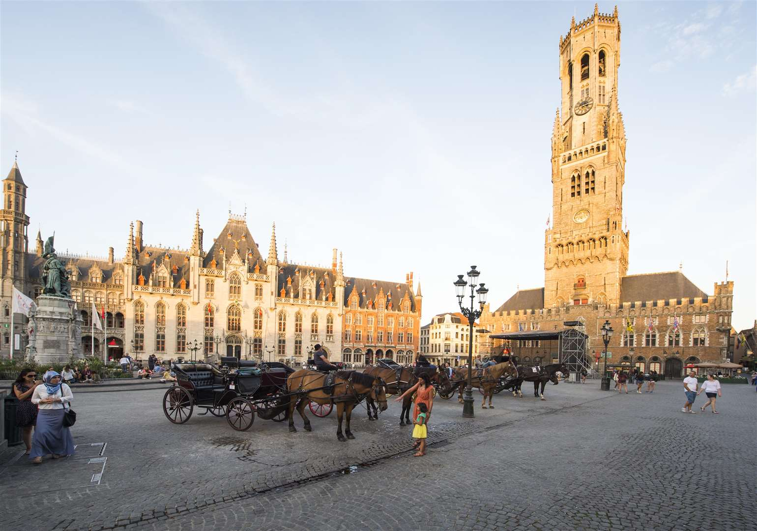 The Markt square features a 13th-century 47 bell carrillon belfry and 83 meter tower