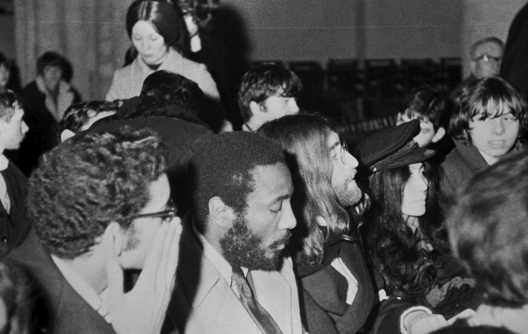 John Lennon and Yoko Ono at midnight mass in Rochester Cathedral in 1969. With them is the American comedian Dick Gregory