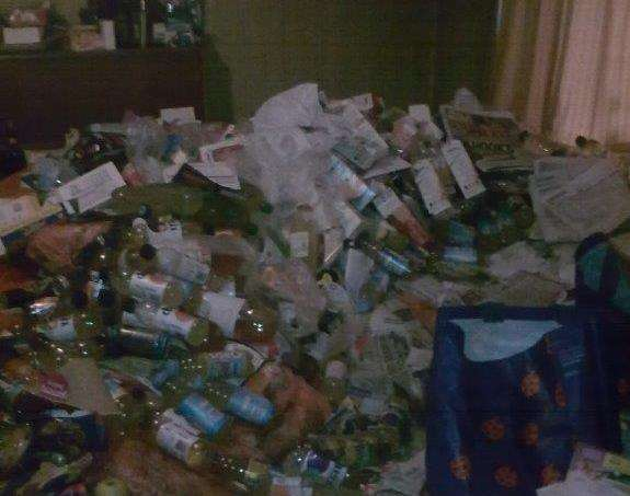 Empty bottles and paper cover the carpet
