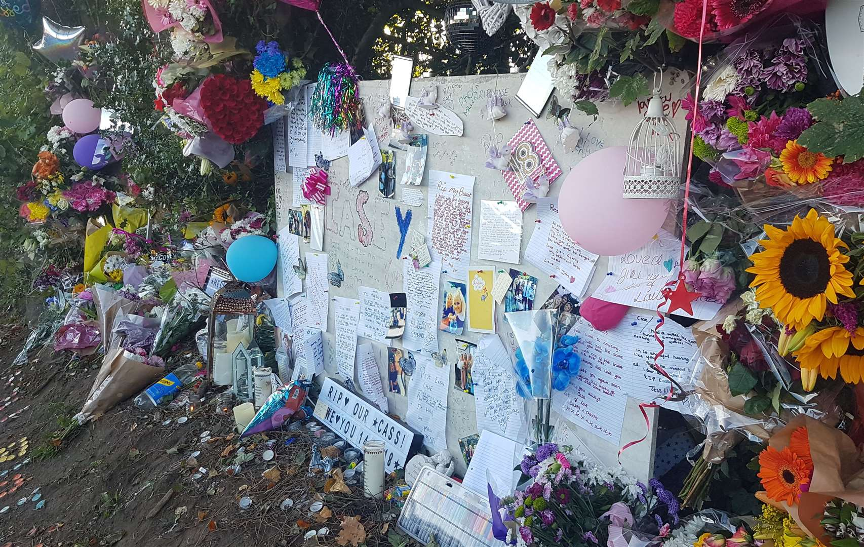 Tributes to Casey Hood were left at the roadside