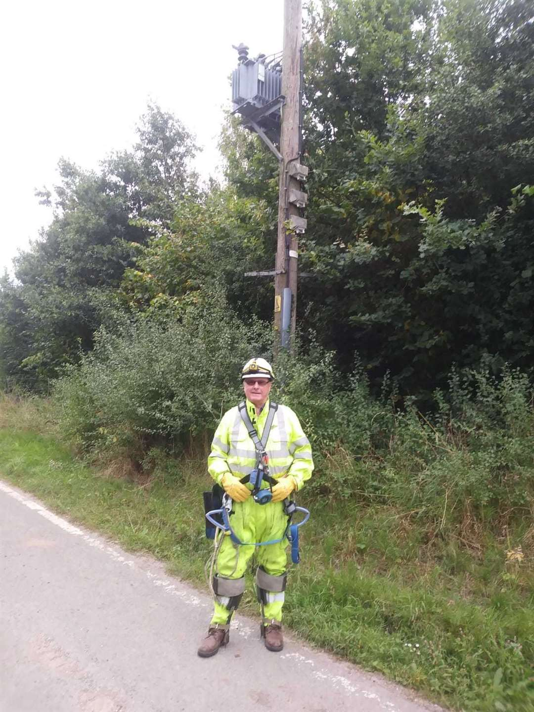 Age-defying Mr Lewry climbs high poles at 71.. Picture courtesy of UK Power Networks