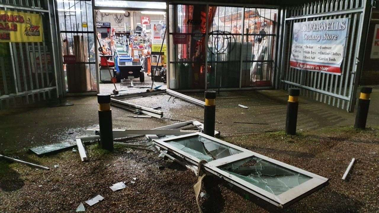 Doors lie smashed on the ground after being towed out by a 4x4