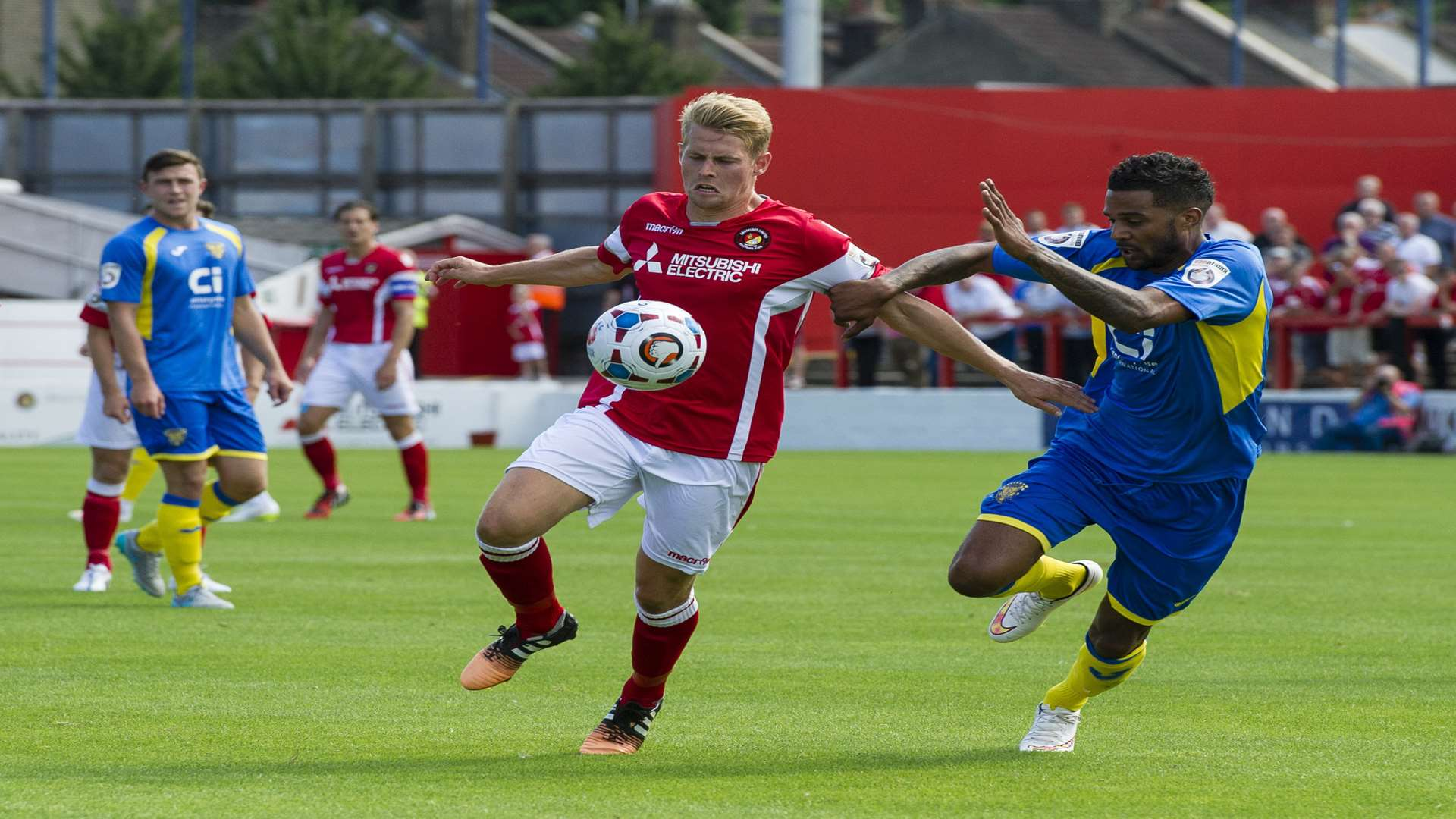 Jordan Parkes battles with Basingstoke's Louie Soares on his Ebbsfleet debut Picture: Andy Payton
